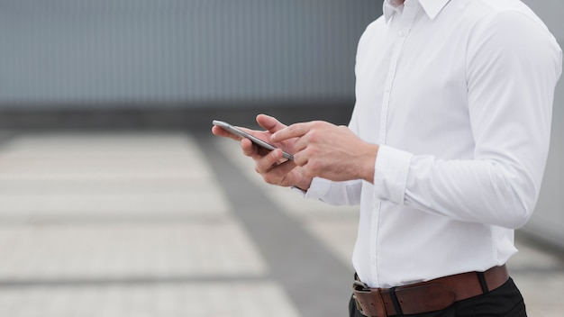 Business man holding phone close up Free Photo