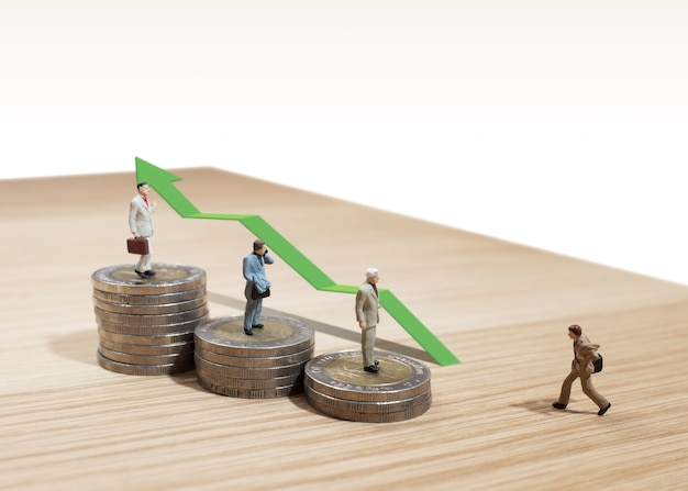 Business man miniature concept move to success business finance and marketing Premium Photo