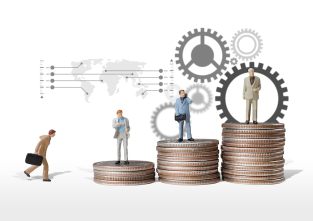 Business man miniature figure concept move to success business finance and marketing Premium Photo