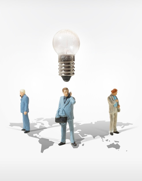 Business man miniature figure concept move to success business finance and marketing Premium Photo