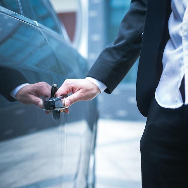 Business man opens the door Free Photo