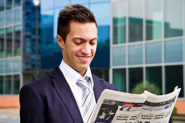 Business man reading a newspaper Premium Photo