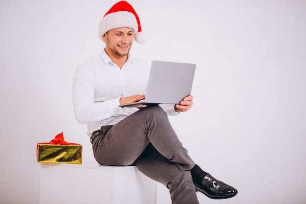 Business man in santa hat shopping online on christmas Free Photo