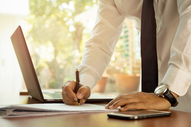 Business man signing contract making a deal team leader ambition concept. Premium Photo