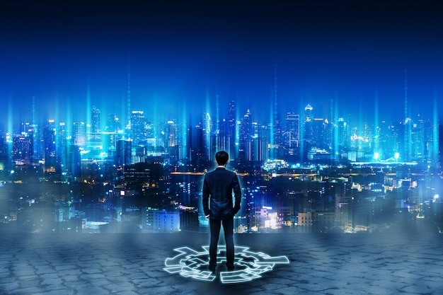 Business man standing on future network city Premium Photo