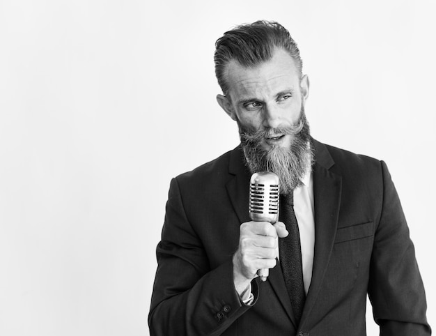 Business man talking on microphone grayscale Free Photo