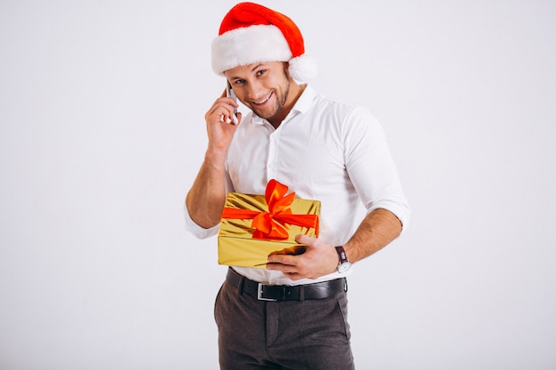 Business man talking on phone in santa hat isolated on white background Free Photo