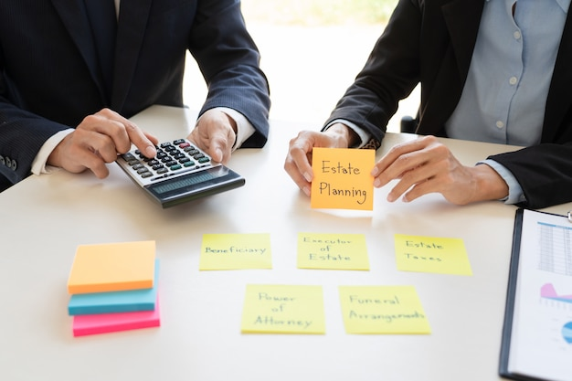 Business man and team analyzing financial statement for planning financial customer case in office. Premium Photo