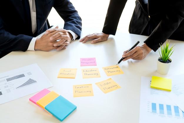 Business man and team analyzing financial statement. Premium Photo