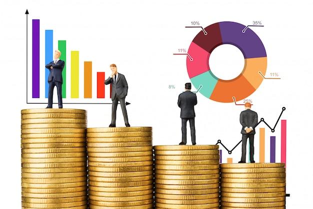 Business man teamwork on gold coin graph chart Premium Photo