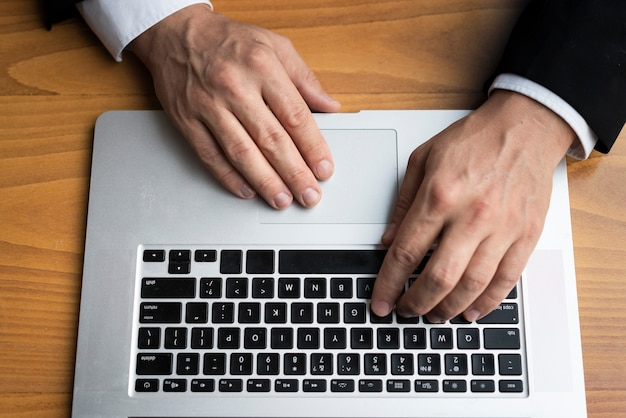 Business man typing on laptop Free Photo