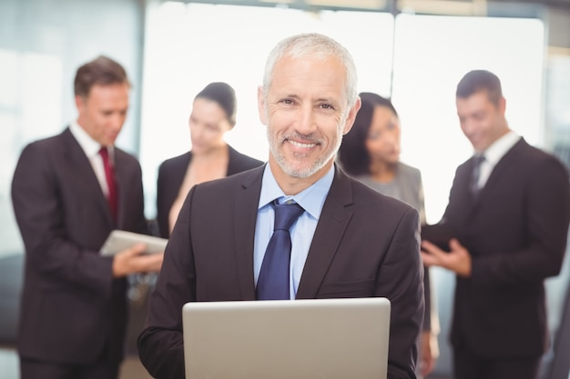 Business man using laptop in office Premium Photo