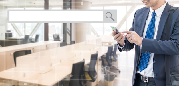Business Man Using Smart Phone With Blank Search Bar At Office Space  Background   Business And Search Engine Concept. Premium Photo