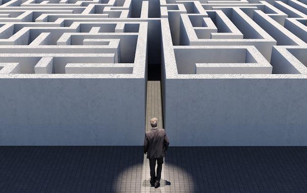 Business man walking to challenge an endless maze Premium Photo