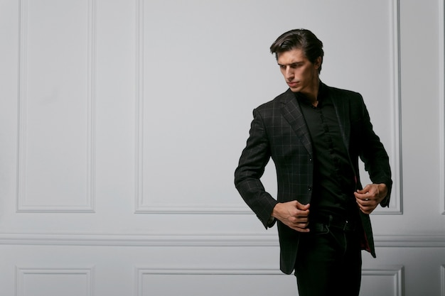 Business man wear black suit portrait against a dark background. closeup portrait of a handsome man
