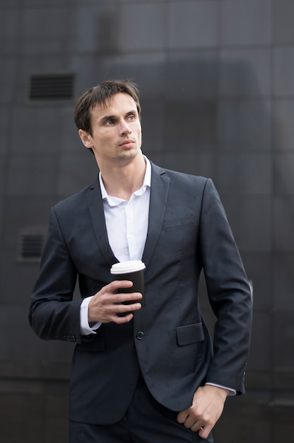 Business man with coffee on break Free Photo