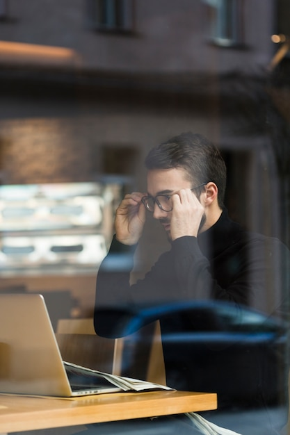Business man with glasses working Free Photo