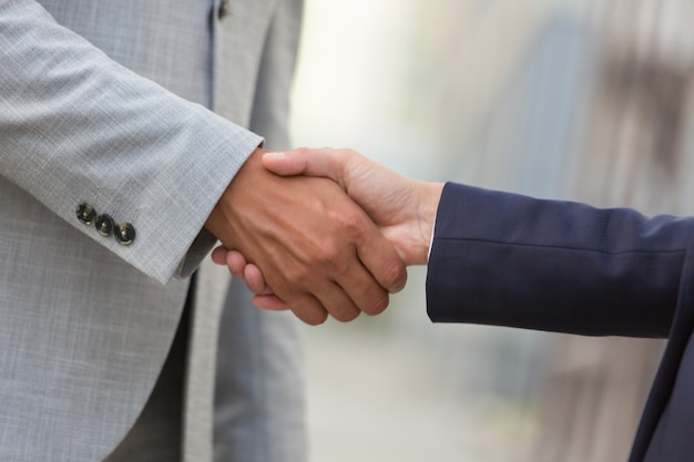 Business man and woman greeting each other Free Photo