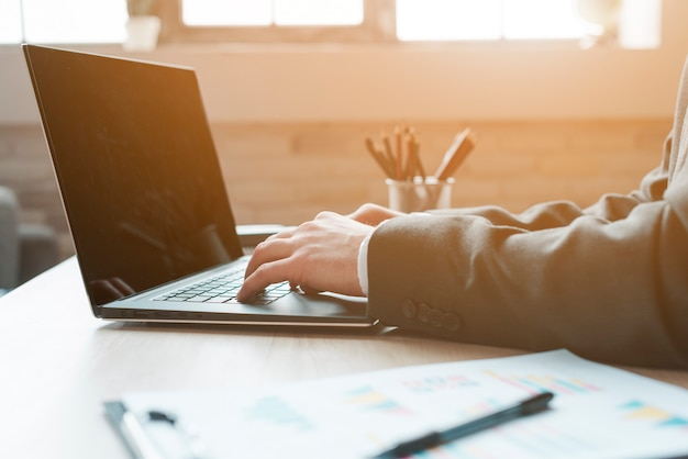 Business man working in a office desktop Free Photo