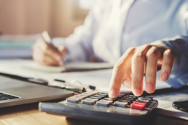 Business man working in office and using calculator Premium Photo