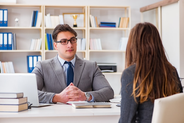 Business meeting between businessman and businesswoman Premium Photo