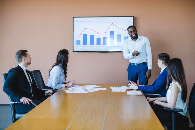 Business meeting at long table with chart Free Photo