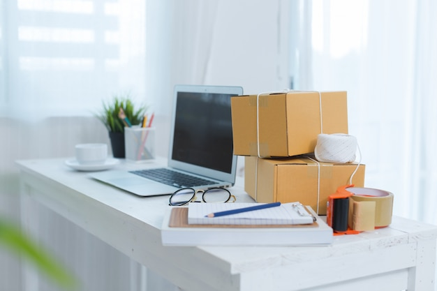 Business owner working at home office packaging Free Photo