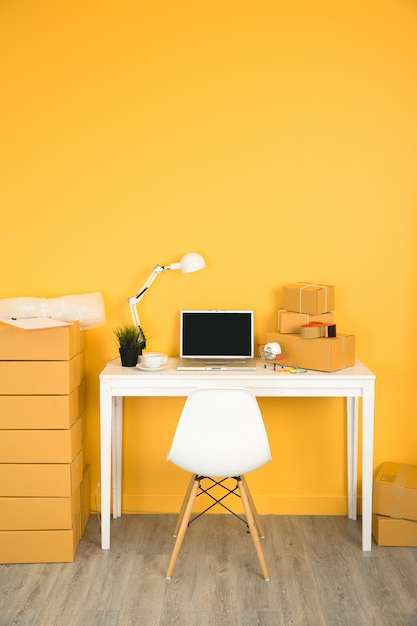 Business owner working at home office packaging . Free Photo