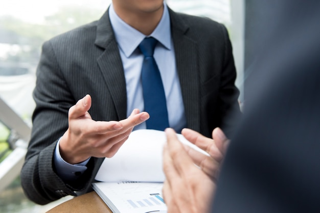 Business partners discussing document at the meeting Premium Photo