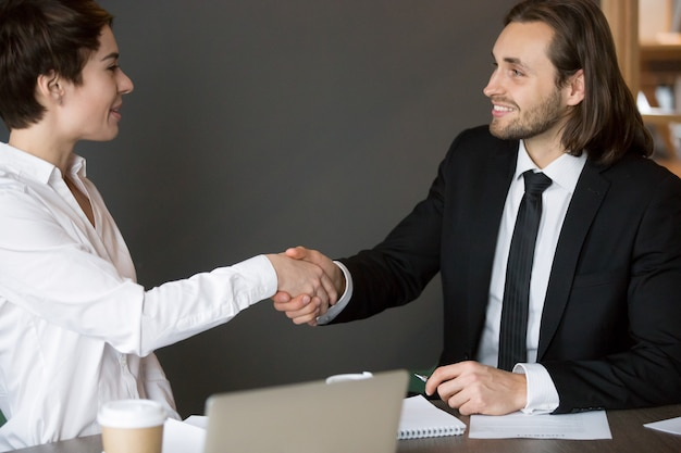 Business partners handshaking after closing successful deal Free Photo