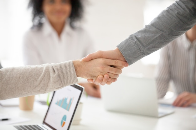 Business partners handshaking at group meeting making project investment, closeup Free Photo
