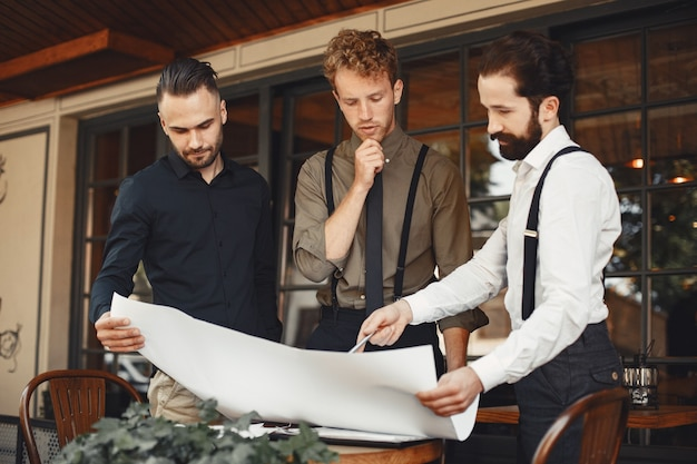 Business partners hold discussions. men in business suits are talking. man in suspenders with a beard. Free Photo