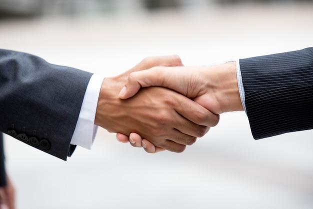 Business partners making firm handshake Premium Photo