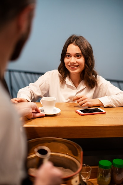 Business partners meeting at coffee shop Free Photo