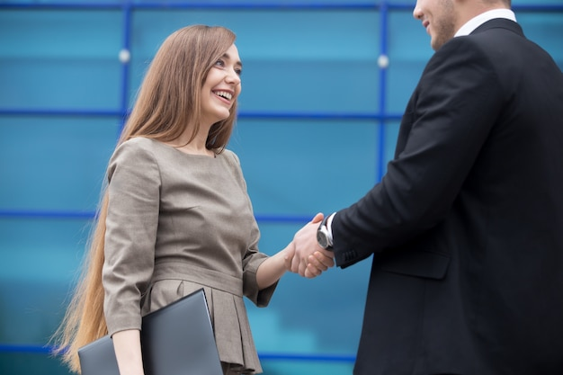 Business partners shaking hands Free Photo