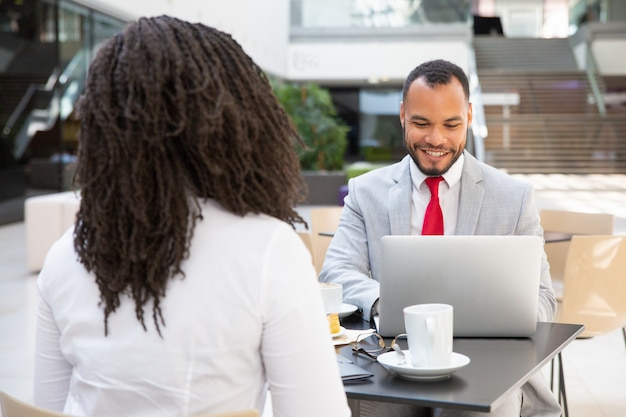 Business partners talking over cup of coffee Free Photo