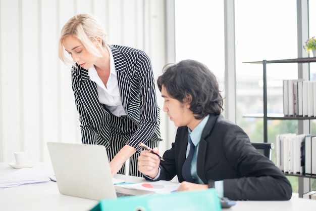 Business people are analyzing financial report Premium Photo