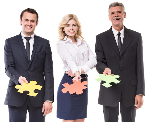 Business people are wanting puzzle together on white. Premium Photo