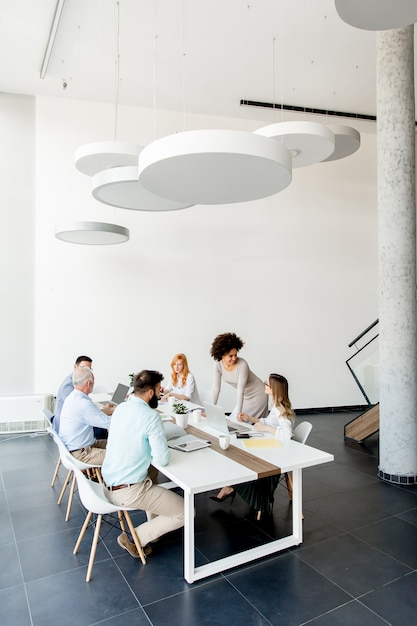 Business people around table during staff meeting Premium Photo