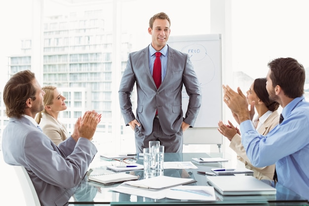 Business people clapping hands in board room meeting Premium Photo