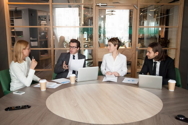 Business people discussing new design project at executive team meeting Free Photo