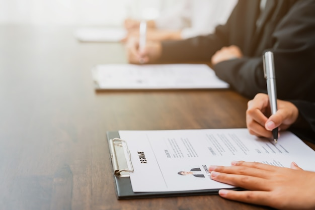 Business people fill resume application information on the desk, presents the ability for the company to agree with the position of the job. Premium Photo