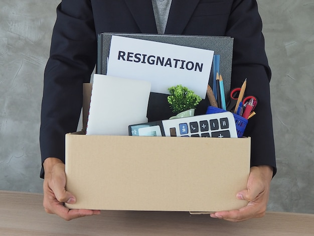 Business people hold personal belongings and resignation letters Premium Photo