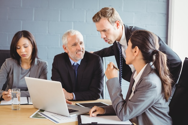 Business people interacting in conference room Premium Photo