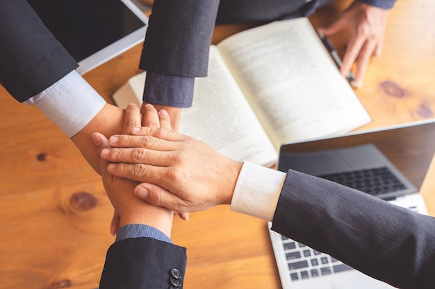 Business people joining hands after successful meeting. Premium Photo