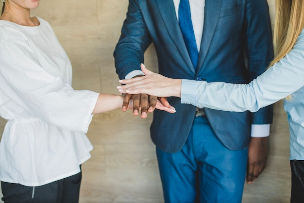 Business people laying hands together Free Photo