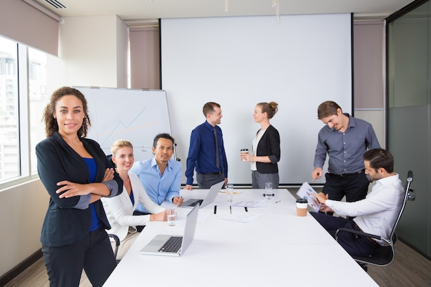 Business people posing smiling in a meeting room Free Photo