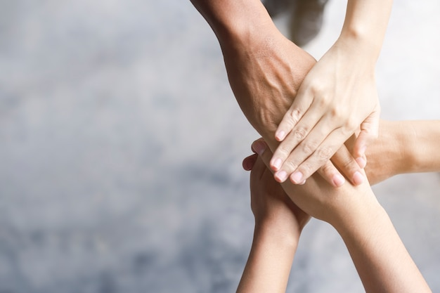 Business people put hands together Premium Photo