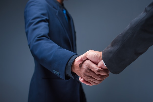 Business people shake hands in the office Premium Photo
