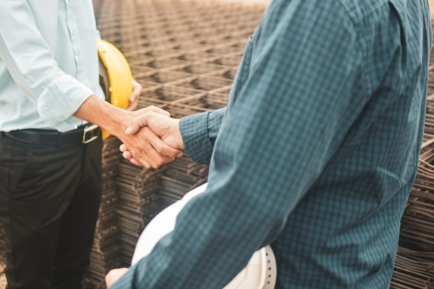 Business people shaking hands agreement success project estate building construction,hand shake agreement concept Premium Photo